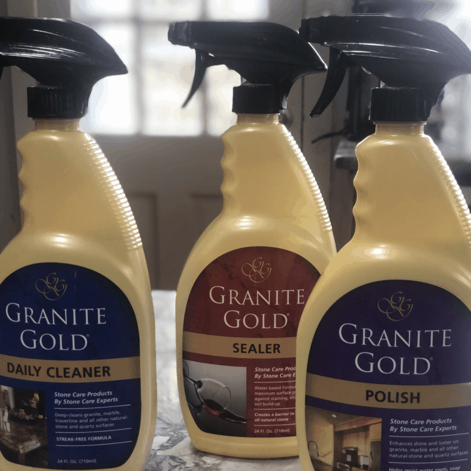 three bottles of tile cleaner