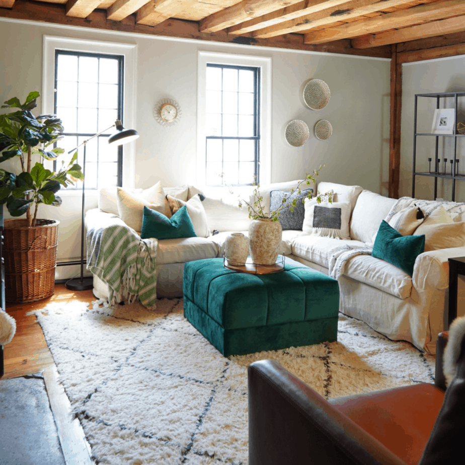 white couch, wood ceiling, and green ottoman
