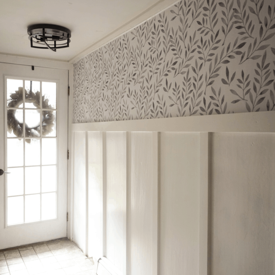 leaf wall paper and a white board and batten wall
