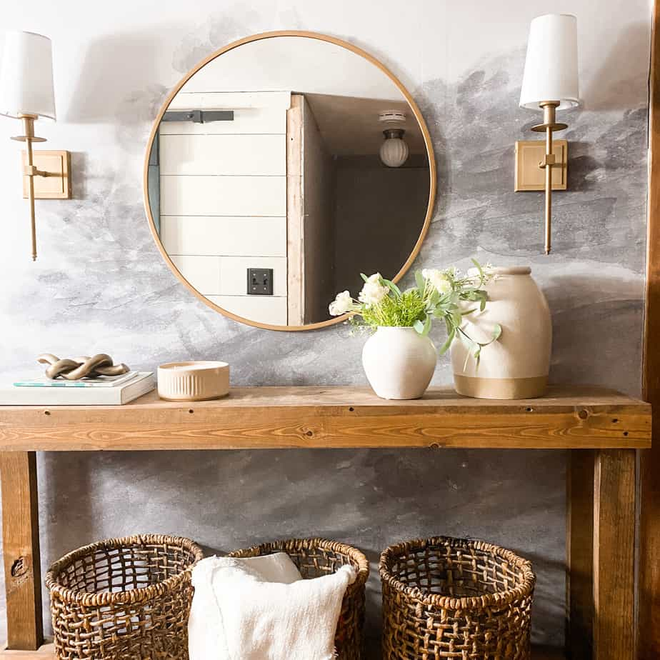Easy Entryway styling, wooden table with gold mirror and lights with decor on table