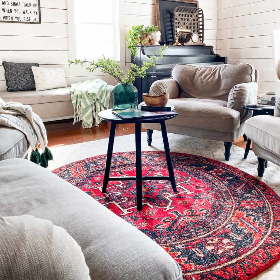 living room with red rug